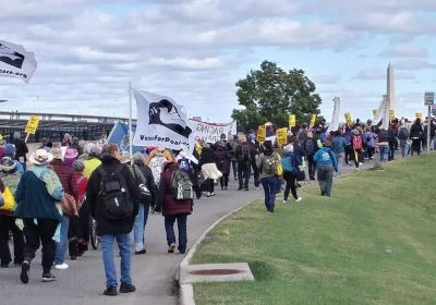 Anti-War protesters march around Pentagon