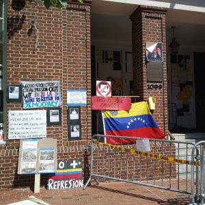 Pro-regime change supporters tape anti-Maduro signs